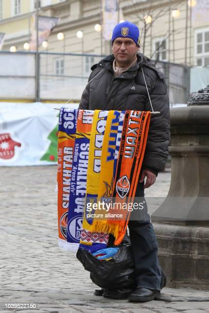 Scarfs of the soccer clubs of Donezk and Schalke being sold by a man in Lviv Ukraine 18 February 2016 Photo Friso Gentsch/dpa | usage worldwide