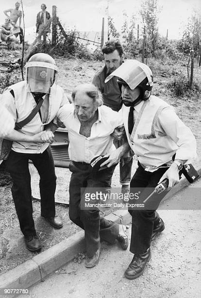 �Scargill is helped away by ambulance men after an incident at Orgreave when he alleged he was attacked by police� A number of confrontations between...