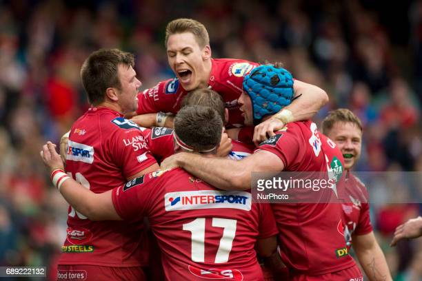 Scarlert rugby players celebrate after score during the Guinness PRO12 Final between Munster Rugby and Scarlets at Aviva Stadium in Dublin, Ireland...