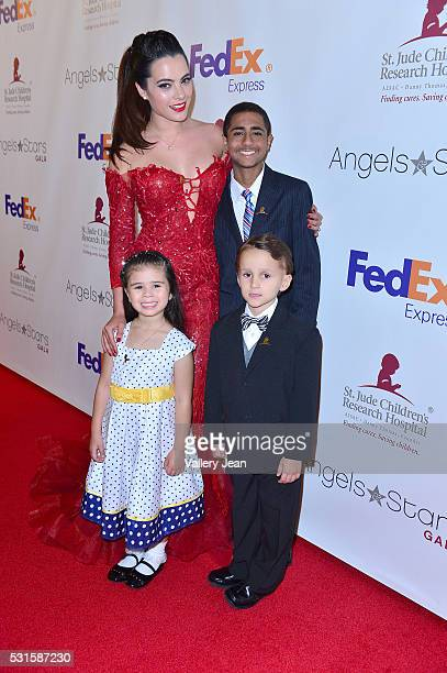 Scarlet Gruber and St Jude Patients Christopher Quinones Crista Anleu and Nicolas Maxwell attends the FedEx / St Jude Angels and Stars Gala at Hotel...