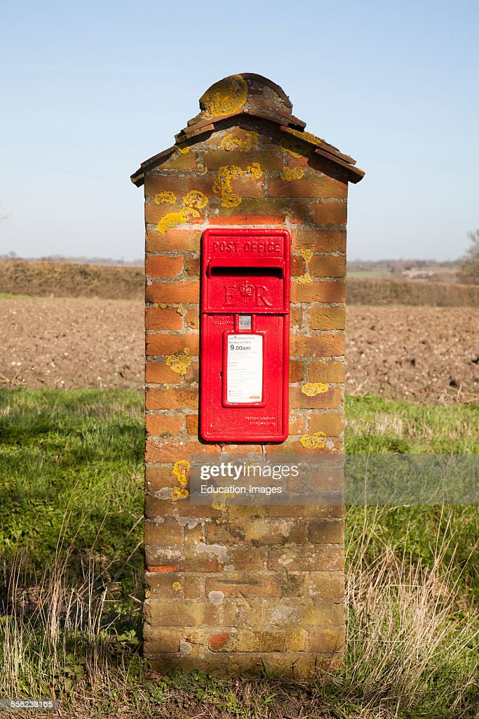 Scarlet Red Post Office Pillar Box Mounted In Brick With Fields Background Hoo