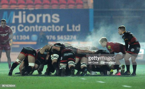 Scarlets' Aled Davies places the ball into the scrum during the Guinness Pro14 Round 13 match between Scarlets and Dragons at Parc y Scarlets on...