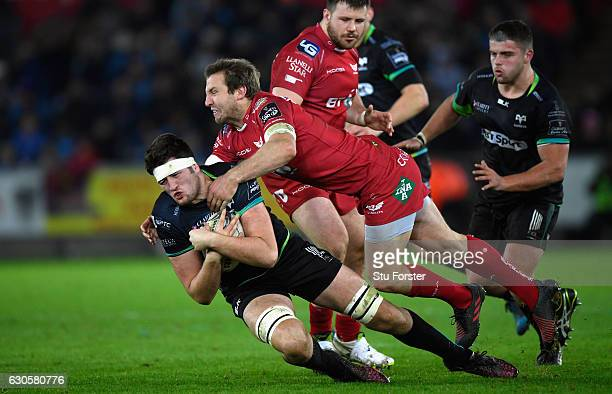 Scarlets centre Hadleigh Parkes tackles Rory Thornton of the Ospreys during the Guinness Pro 12 match between Ospreys and Scarlets at Liberty Stadium...