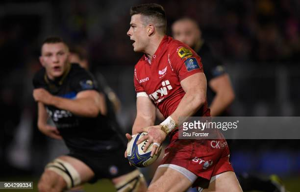 Scarlets centre Scott Williams makes a break during the European Rugby Champions Cup match between Bath Rugby and Scarlets at Recreation Ground on...