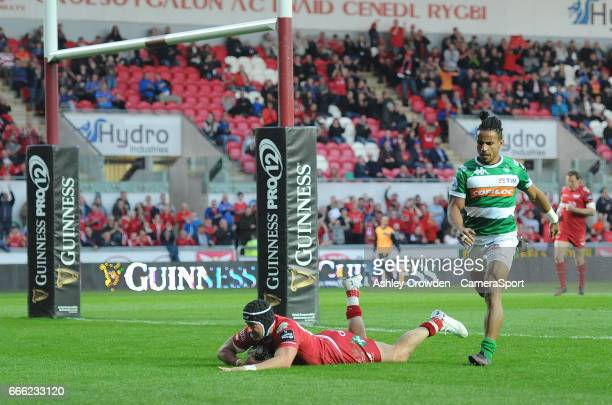 TRY Scarlets' DTH Van Der Merwe scores his sides third try during the Guinness Pro12 Round 19 match between Scarlets and Benetton Treviso at Parc y...