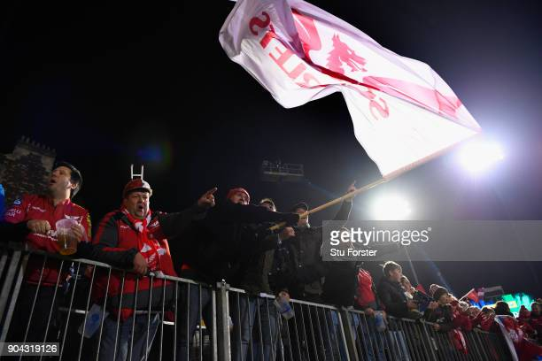Scarlets fans celebrate after the European Rugby Champions Cup match between Bath Rugby and Scarlets at Recreation Ground on January 12 2018 in Bath...