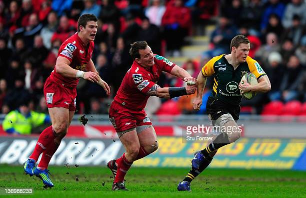 Scarlets hooker Matthew Rees is pushed aside by Chris Ashton of the Saints during the Pool One Heineken Cup Match between Scarlets and Northampton...
