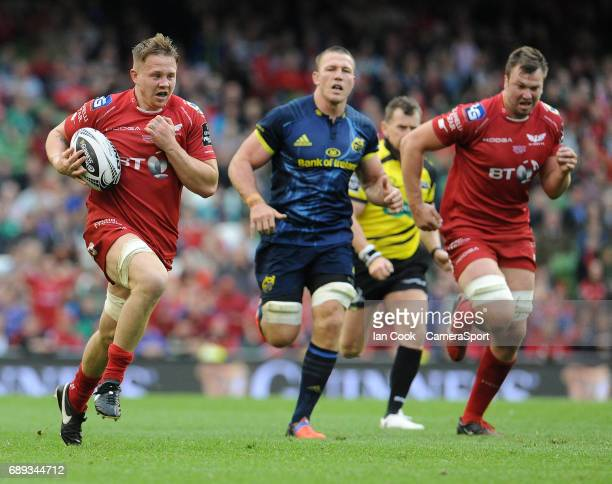 Scarlets' James Davies breaks through and goes onto score the Scarlets 6th try during the Guinness PRO12 Final match between Munster and Scarlets at...