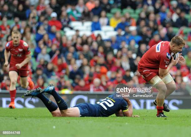Scarlets' James Davies evades the tackle from Munster's Ian Keatley during the Guinness PRO12 Final match between Munster and Scarlets at the Aviva...