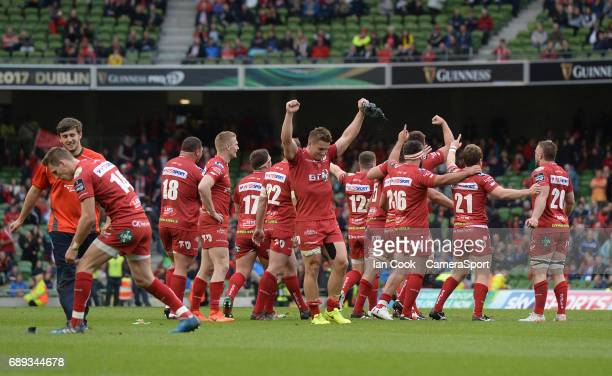 Scarlets' Jonathan Davies and his teammates celebrate at the final whistle during the Guinness PRO12 Final match between Munster and Scarlets at the...