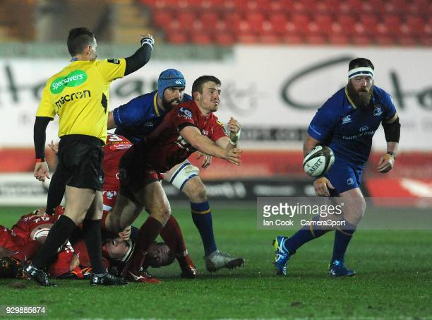 Scarlets' Jonathan Evans whips the ball out during the Guinness Pro14 Round 17 match between Scarlets and Leinster Rugby at Parc y Scarlets on March...