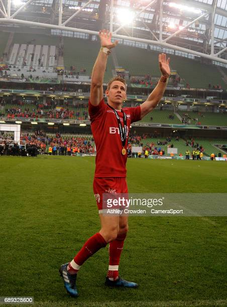 Scarlets' Liam Williams waves goodbye to Scarlets fans after playing his last game during the Guinness PRO12 Final match between Munster and Scarlets...