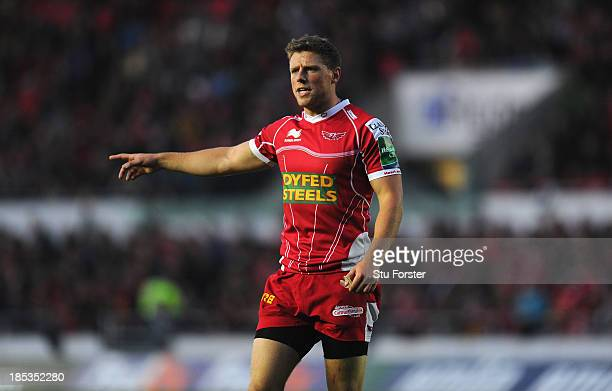 Scarlets player Rhys Priestland reacts during the Heineken Cup Pool 4 match between Scarlets and Racing Metro 92 at Parc y Scarlets on October 19...