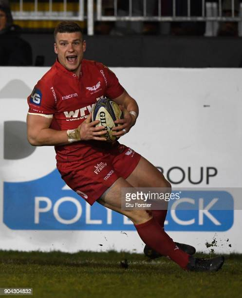 Scarlets player Scott Williams goes over for the bonus point fourth try during the European Rugby Champions Cup match between Bath Rugby and Scarlets...