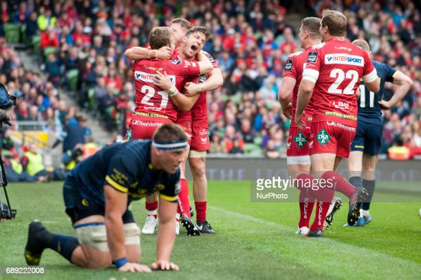 Scarlets players celebrate after DTH van der Merwe score during the Guinness PRO12 Final between Munster Rugby and Scarlets at Aviva Stadium in...