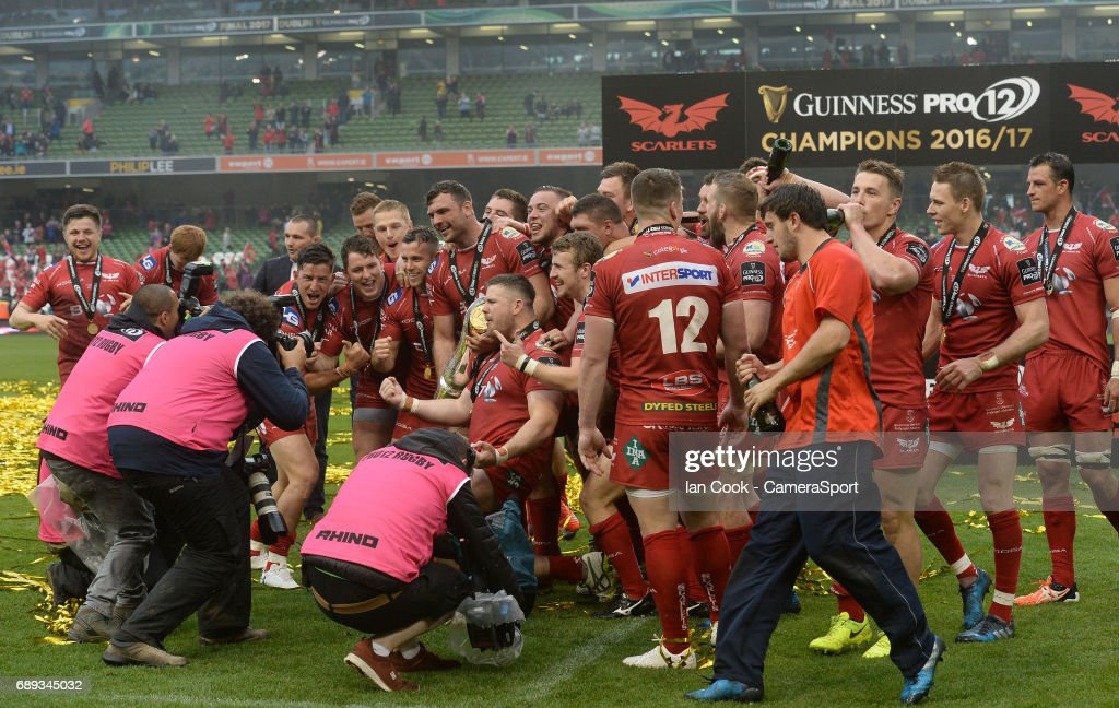Scarlets players celebrate and pose for photographers after beating Munster in the final during the Guinness PRO12 Final match between Munster and Scarlets at the Aviva Stadium on May 27, 2017 in Dublin, Ireland.