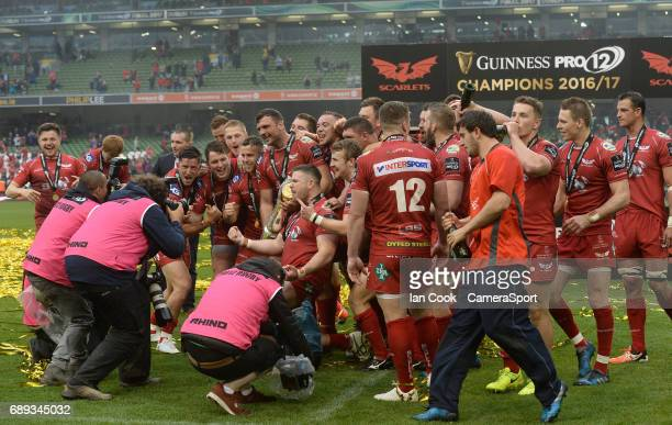 Scarlets players celebrate and pose for photographers after beating Munster in the final during the Guinness PRO12 Final match between Munster and...