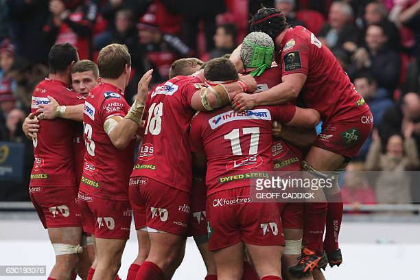 Scarlets players celebrate at the final whistle in the European Champions Cup rugby union pool 3 match between Scarlets and Toulon at Parc y Scarlets...
