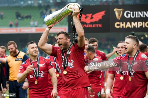 Scarlets players celebrate with the trophy after the Guinness PRO12 Final between Munster Rugby and Scarlets at Aviva Stadium in Dublin Ireland on...