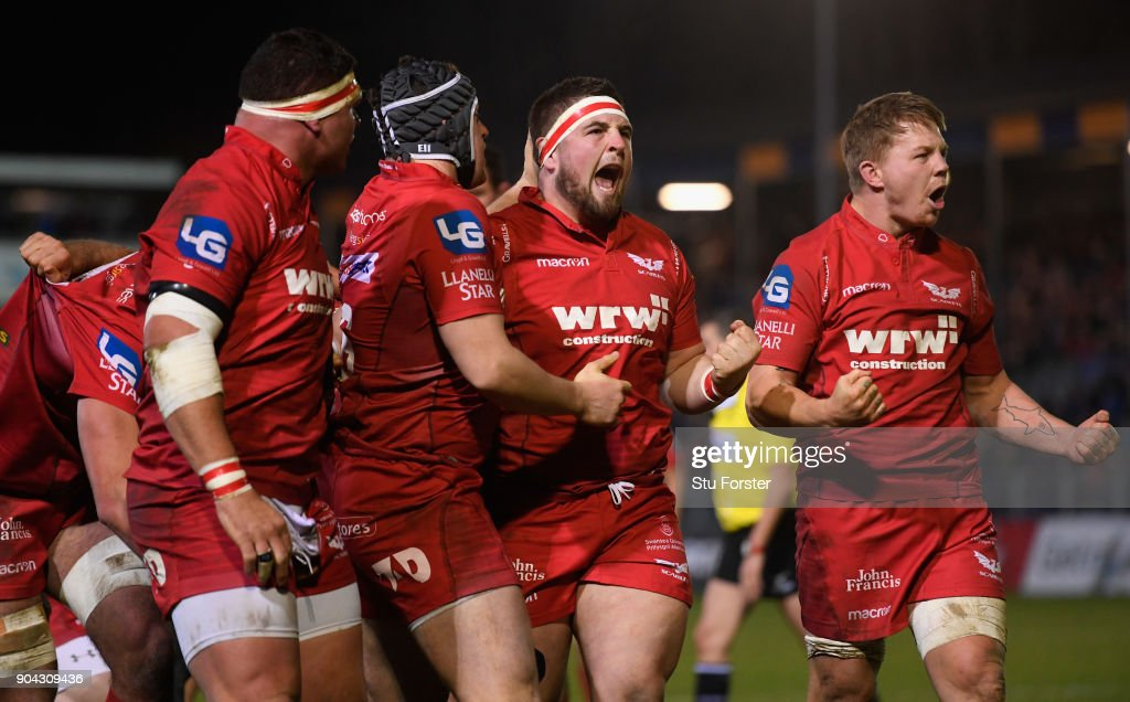 Scarlets players Wyn Jones (c) and James Davies (r) celebrate after forcing a penalty out of Bath during the European Rugby Champions Cup match between Bath Rugby and Scarlets at Recreation Ground on January 12, 2018 in Bath, England.