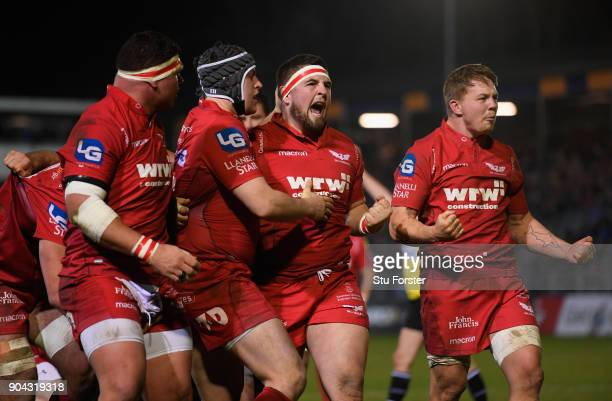 Scarlets players Wyn Jones and James Davies celebrate after forcing a penalty out of Bath during the European Rugby Champions Cup match between Bath...