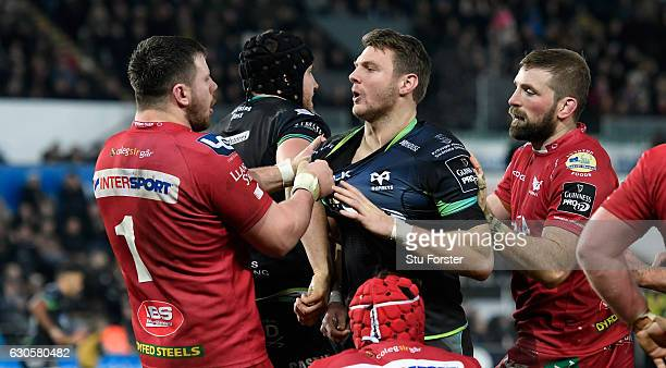 Scarlets prop Rob Evans and Dan Biggar of the Ospreys become involved in a bit of handbags after the first Ospreys try is awarded during the Guinness...