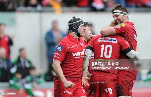 CELE Scarlets' Rhys Patchell celebrates scoring his sides third try with team mate Steve Cummins during the Guinness PRO14 Round 19 match between...