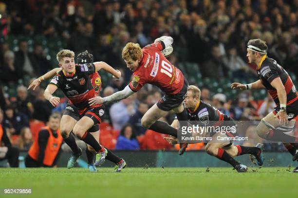 Scarlets' Rhys Patchell is tackled by Sarel Pretorius during the Guinness PRO14 Round 21 Judgement Day VI match between Cardiff Blues and Ospreys at...