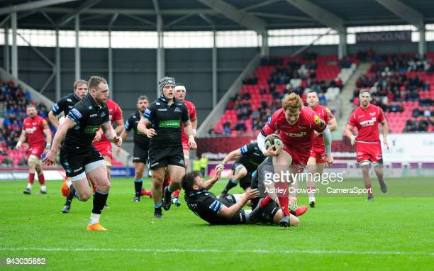 TRY Scarlets' Rhys Patchell scores his sides first try during the Guinness PRO14 Round 19 match between Scarlets and Glasgow Warriors at Parc y...