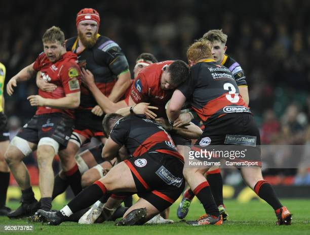 Scarlets' Rob Evans is tackled by Dragons' Thomas Davies during the Guinness PRO14 Round 21 Judgement Day VI match between Cardiff Blues and Ospreys...