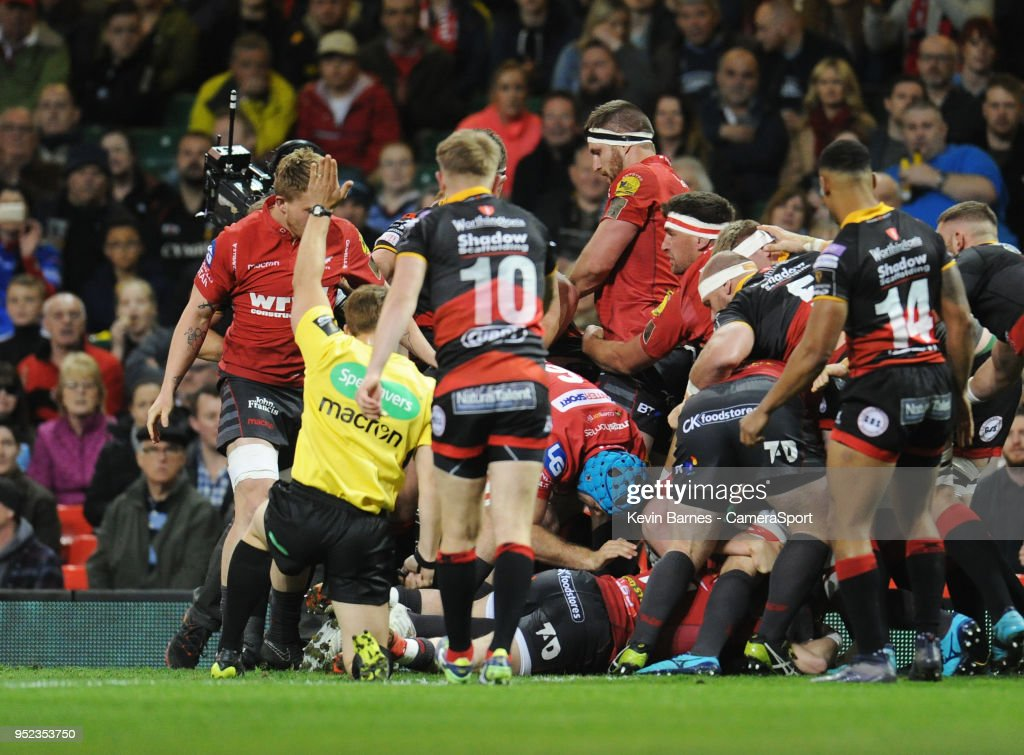 Scarlets' Ryan Elias (obscured) scores his sides first try during the Guinness PRO14 Round 21 Judgement Day VI match between Cardiff Blues and Ospreys at Principality Stadium at Principality Stadium on April 28, 2018 in Cardiff, Wales.