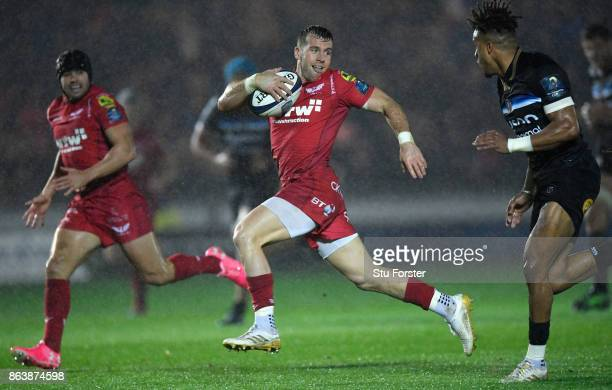 Scarlets scrum half Gareth Davies breaks past Anthony Watson to set up the first try during the European Rugby Champions Cup match between Scarlets...