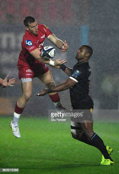 Scarlets scrum half Gareth Davies competes for a loose ball with Aled Brew during the European Rugby Champions Cup match between Scarlets and Bath...