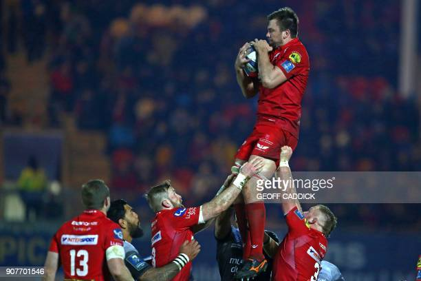 Scarlets' South African lock David Bulbring claims the ball during the European Champions Cup rugby union pool 5 match between Scarlets and Toulon at...