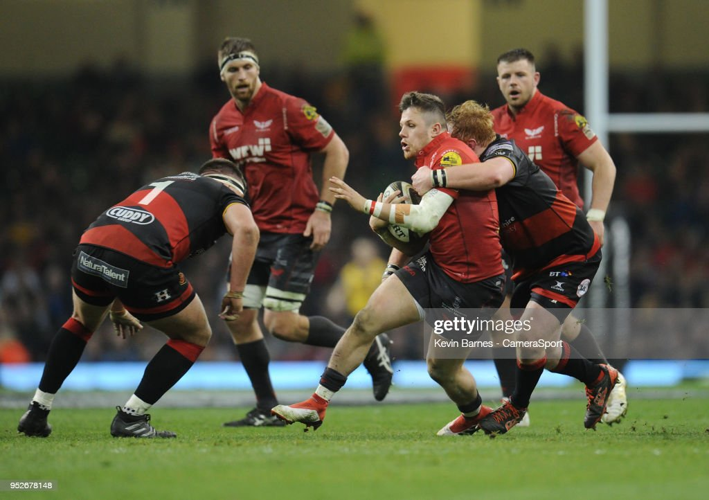 Scarlets' Steff Evans is tackled by Dragons' Dan Suter during the Guinness PRO14 Round 21 Judgement Day VI match between Cardiff Blues and Ospreys at Principality Stadium at Principality Stadium on April 28, 2018 in Cardiff, Wales.
