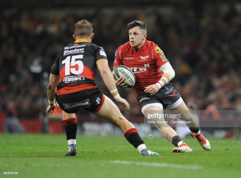 Scarlets' Steff Evans under pressure from Dragons' Hallam Amos during the Guinness PRO14 Round 21 Judgement Day VI match between Cardiff Blues and Ospreys at Principality Stadium at Principality Stadium on April 28, 2018 in Cardiff, Wales.