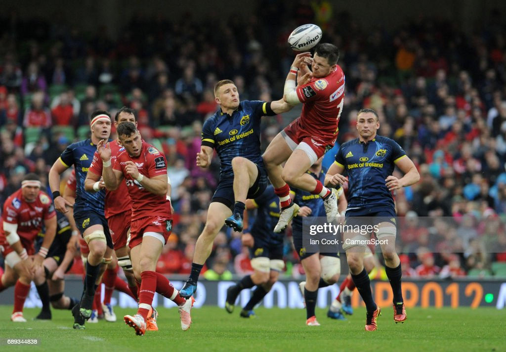 Scarlets' Steffan Evans and Munster's Andrew Conway challenge for the high ball during the Guinness PRO12 Final match between Munster and Scarlets at the Aviva Stadium on May 27, 2017 in Dublin, Ireland.