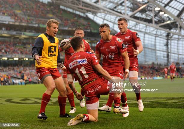 Scarlets' Steffan Evans celebrates scoring his sides second try with team mates during the Guinness PRO12 Final match between Munster and Scarlets at...