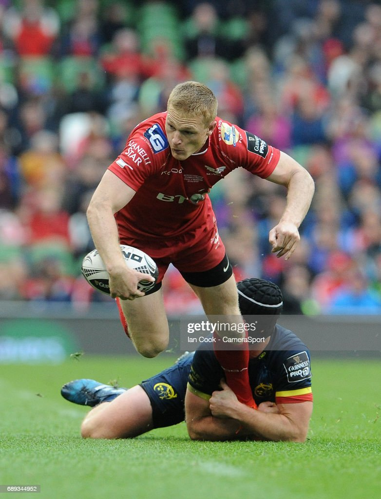 Scarlets' Steffan Evans is tackled by Munster's Tyler Bleyendaal during the Guinness PRO12 Final match between Munster and Scarlets at the Aviva Stadium on May 27, 2017 in Dublin, Ireland.