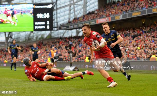 Scarlets' Steffan Evans scores his sides second try during the Guinness PRO12 Final match between Munster and Scarlets at the Aviva Stadium on May 27...