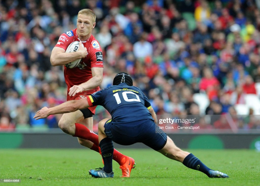 Scarlets' Steffan Evans takes on Munster's Tyler Bleyendaal during the Guinness PRO12 Final match between Munster and Scarlets at the Aviva Stadium on May 27, 2017 in Dublin, Ireland.