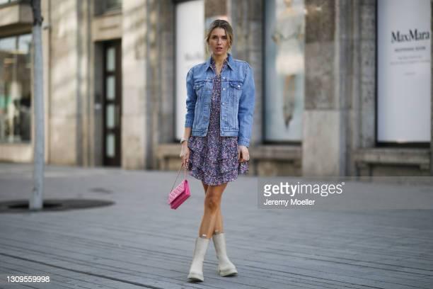Scarlett Gartmann wearing beige Copenhagen Studios boots, Neo Noir flower mini dress, pink Chanel Wallet on Chain bag and blue Levis jeans jacket on...
