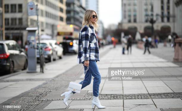 Scarlett Gartmann wearing Gianvitto Rossi boots, Mango Jeans, H&M jacket, Chanel bag and Saint Laurent shirt during the Berlin Fashion Week...