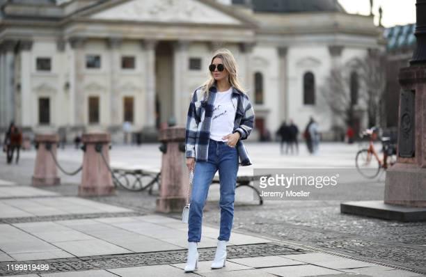 Scarlett Gartmann wearing Gianvitto Rossi boots, Mango Jeans, H&M jacket, Chanel bag and Saint Laurent shirt during the Berlin Fashion Week...