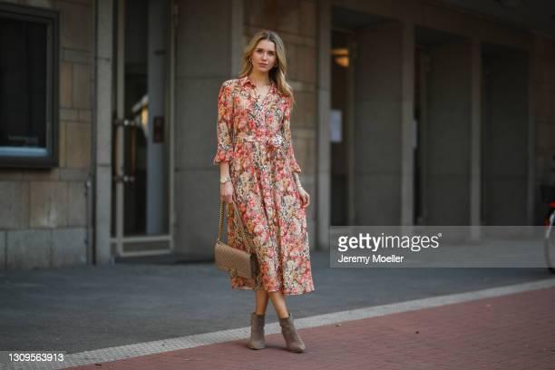 Scarlett Gartmann wearing Mango flower dress, beige Chanel Boy bag and brown Kennel & Schmenger leather boots on March 24, 2021 in Dusseldorf,...