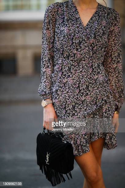 Scarlett Gartmann wearing Neo Noir flower mini dress, black Gucci shades and black YSL fringe bag on March 24, 2021 in Dusseldorf, Germany.