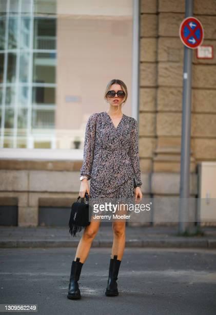 Scarlett Gartmann wearing Neo Noir flower mini dress, black Gucci shades, black YSL fringe bag and black Copenhagen Studios boots on March 24, 2021...