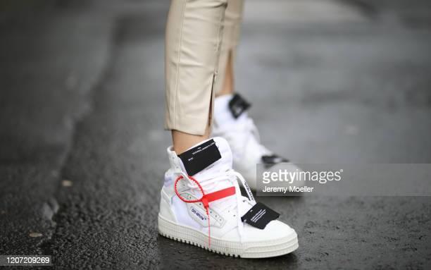 Scarlett Gartmann wearing Off white sneaker and Zara leggings on February 18, 2020 in Dusseldorf, Germany.
