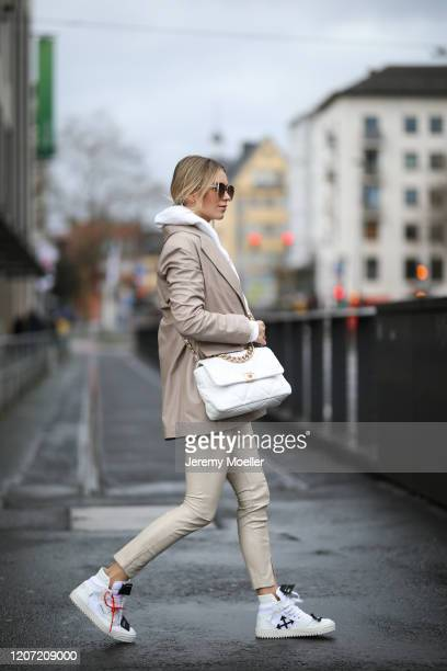 Scarlett Gartmann wearing Off white sneaker, Weekday hoodie, Zara leggings, Zeyneparcay blazer, H&M blazer and Chanel bag on February 18, 2020 in...