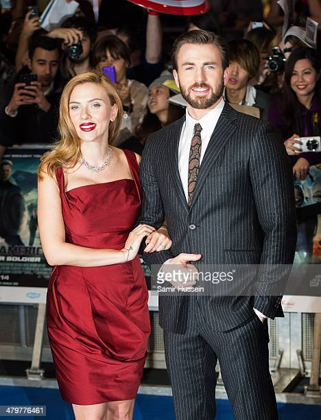 """Scarlett Johansson and Chris Evans attend the """"Captain America: The Winter Soldier"""" UK Film Premiere at Westfield London on March 20, 2014 in London,..."""